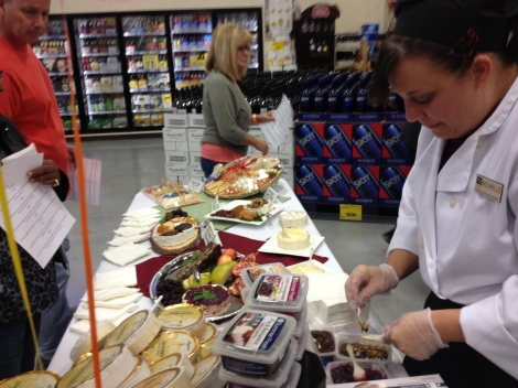 Michelle helping to showcase various Bries for the holidays with lovely toppings to help bring a special vibe to the table.
