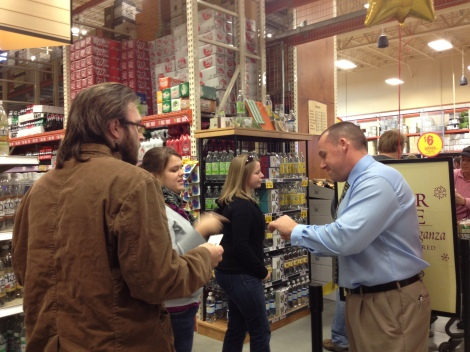 Wine Department Manager, Steve helping to see customers through quickly and safely.