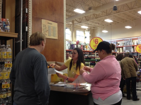 Ashley and the Wine Department Staff helping check ID's and hand out punch cards.