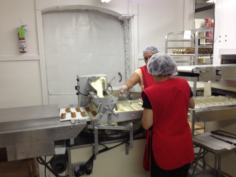 Conveyor belt where the Sweet Sloops start their journey into white chocolate.