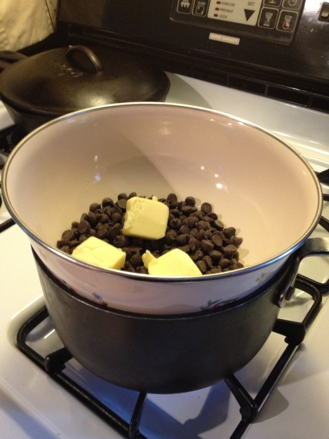 Makeshift double boiler using a saucepan and metal (or glass bowl). Fill the saucepan with one inch of water and place the burner on medium low heat. Stir the chocolate until completely melted and incorporated.