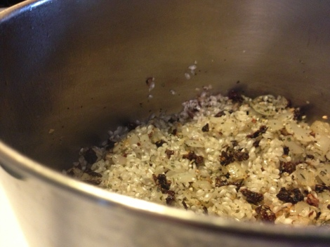 Rice is cooked in the pan before liquid is added, notice the pieces of rice that are translucent around the edges, but opaque in their centers.