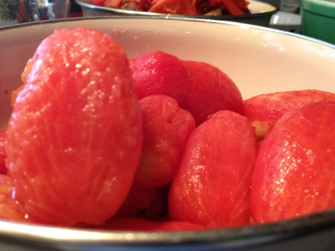 Tomatoes whose skin has been removed and are ready to be seeded and chopped.