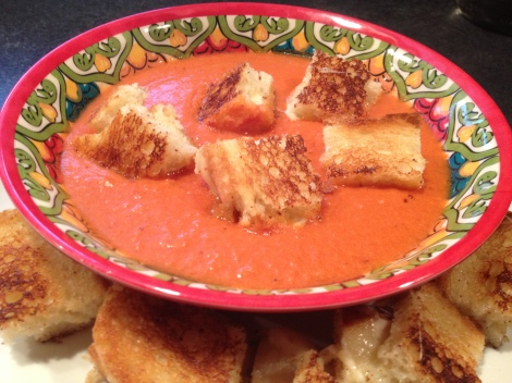 "Tomato bisque with grilled cheese ""croutons""."