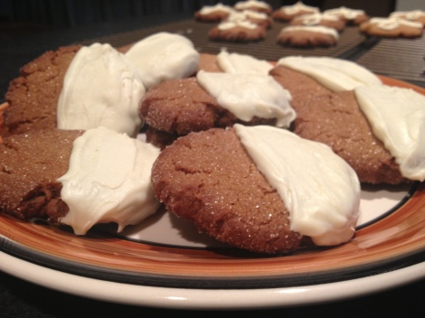 Half and half white chocolate coated spiced gingersnaps.
