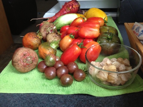 The colorful bounty from my garden at the beginning of season- cucumbers, tomatoes, beets, carrots and cape gooseberries.