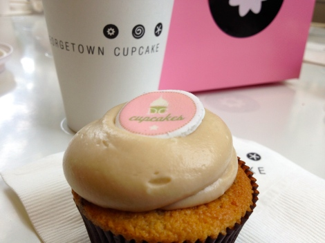 Georgetown Cupcake social media outlets (Facebook and Twitter) alert customers daily as to what flavor they can nab for free. These are limited to 100 per location daily. The telltale sign of these cupcakes is the DC Cupcakes logo on top.