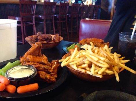 Duff's famous wings with their iconic shoestring fries, always served with celery, carrots and large helpings of blue cheese.